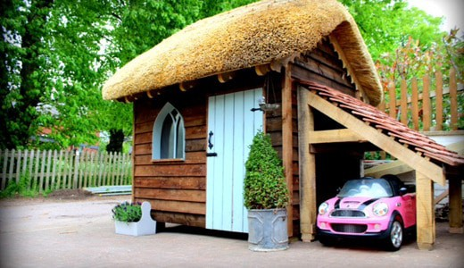 Gothic style thatched playhouse
