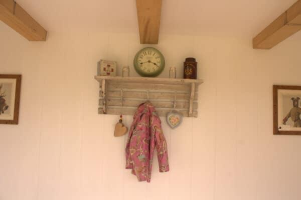 Clock and coat hanger